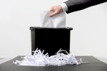 Business-man-shredding-a-document Google042516